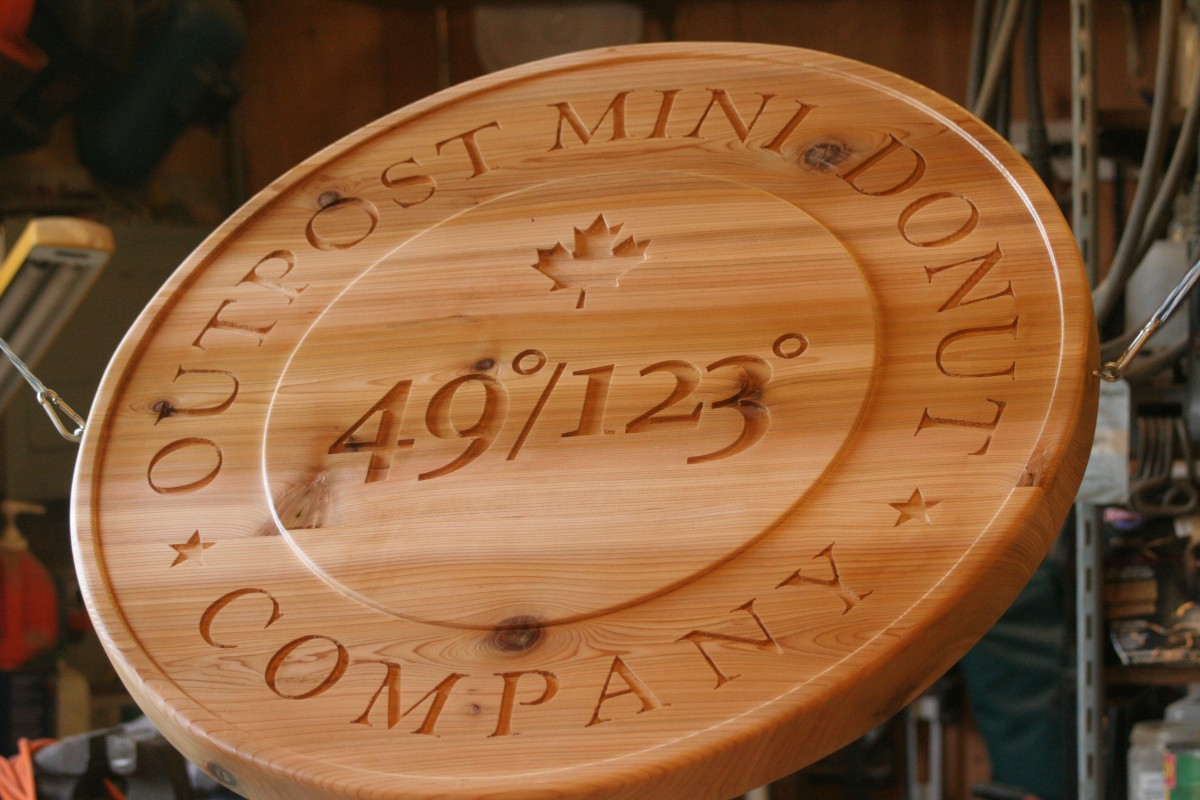 Carved circular wood sign
